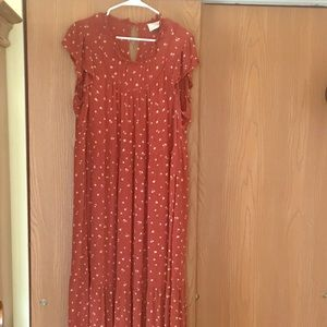 Floral rust orange ruffle dress.